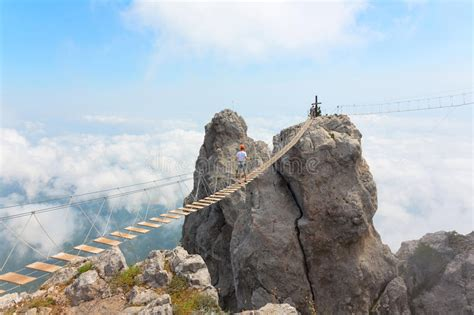 Rope bridge over the chasm stock image